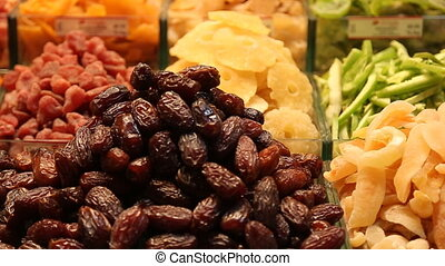 Image of market offering a selection of dried fruits and...