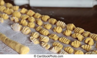 Cut Gnocchi Pasta - Video clip of woman cutting pasta for...