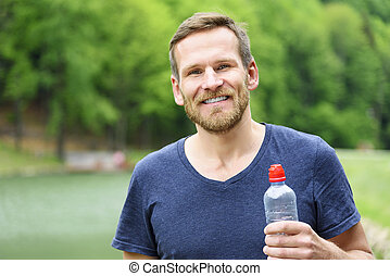 Sportsman with a bottle of water. - Sportsman with a bottle...