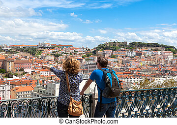 Tourist watching to Lisbon rooftop from Sao Pedro de...