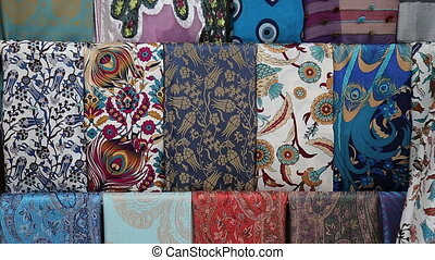 Heap of cloth fabrics at a local market in Turkey - Heap of...