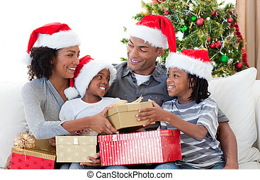 Afro-American family celebrating Christmas at home - Happy...