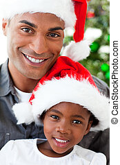Portrait of a smiling father and daughter at Christmas time