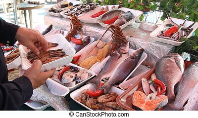 fishmonger sells the fresh fish at the fish market in Turkey...