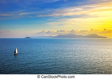 Elba island sunset view from Piombino an sail boat....
