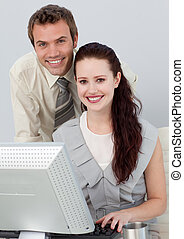 Young business people using a computer
