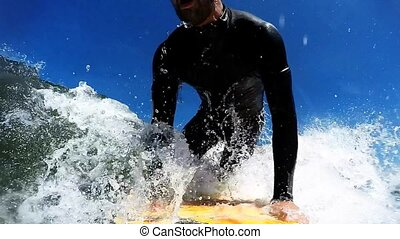 Surfing in Waves - Young man enjoying the surfing in Waves