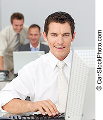 Businessman working with a computer in a company