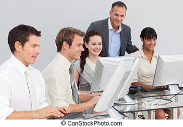 Young businessman and his colleagues working with computers...
