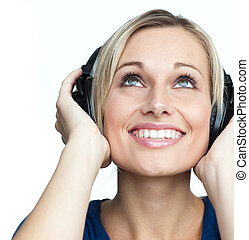 Portrait of girl listening to music on headphones - Portrait...