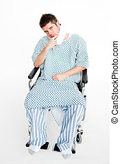 Patient sitting in a wheelchair with a neck brace in hospital