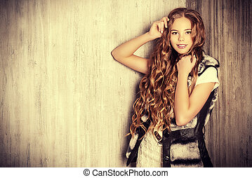 curly long hair - Fashion shot of a pretty teenager girl...