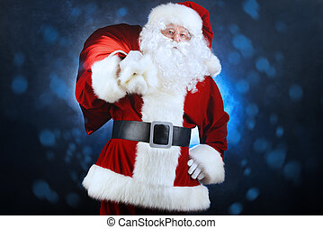 nicholas - Santa Claus stands with a huge bag of gifts over...