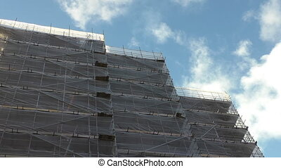 Construction site, bright clouds - Construction site safety...