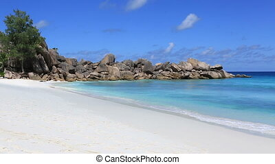 Waves at beautiful beach Grande Anse Island of La Digue in...