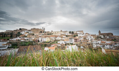 4K Time Lapse of Caceres, cloudy sky, blurred grass - Wide...