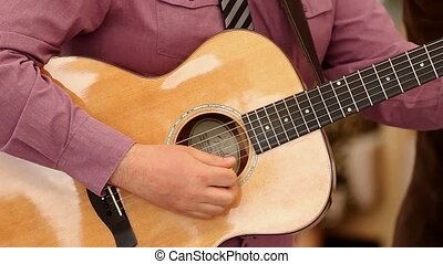 Man playing acoustic guitar Ukraine