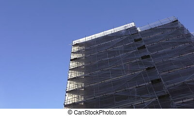 House construction against blue sky - Low angle view of a...