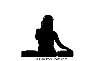 Dj girl in sexy clothes, flipping hair, hand up, dancing...