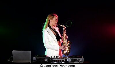 Young sexy, blonde woman dj in white jacket playing music...