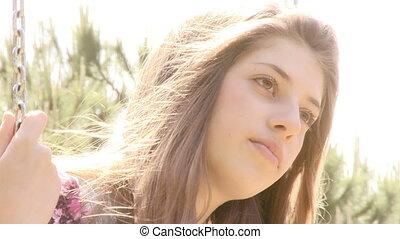 Closeup of sad teenager outdoors