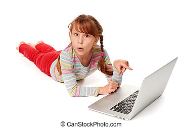 Surprised girl pointing at laptop screen - Surprised little...