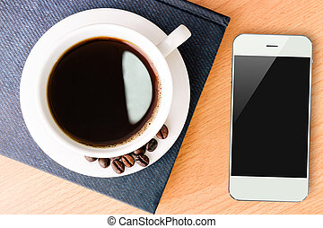 coffee and smartphone mobile on wood table