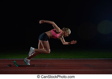 woman  sprinter leaving starting blocks