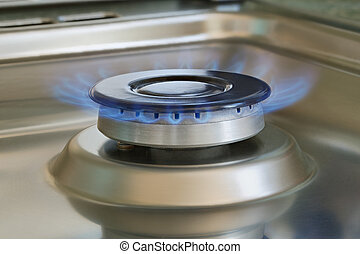 Flames of gas stove, closeup, indoors shot, natural gas