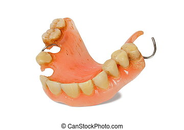 Denture - Old used denture on white background.