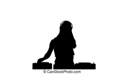 Dj girl in sexy clothes, flipping hair, hands up and claps,...