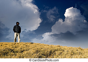 One man standing on the hill