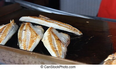 cooking Fish in Bazaar, Istanbul - Burger with fried fish in...