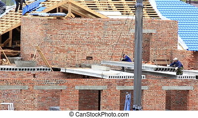 Laying of concrete slabs on brick wall - Laying of concrete...