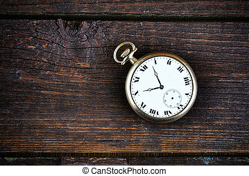 old watch on wooden background