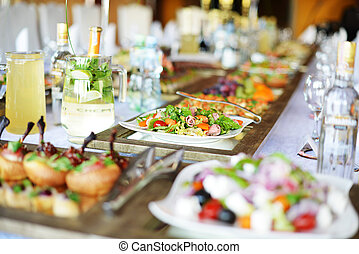 Wedding reception place ready for guests. table with food...