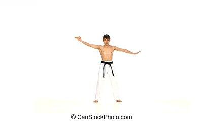 Man training taekwondo or karate Isolated on white - Man...