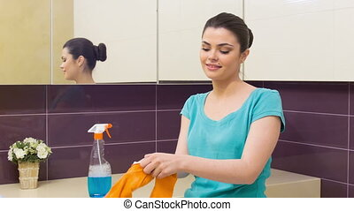 Young woman putting on orange gloves - My hands will be...