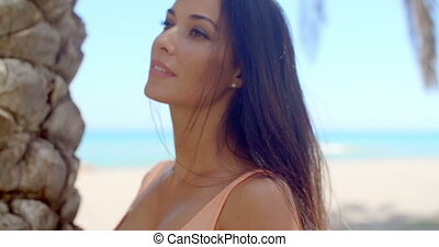 Woman with Long Dark Hair Looking Over Shoulder
