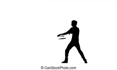 young karate man expertly twirling nunchaku, silhouette -...