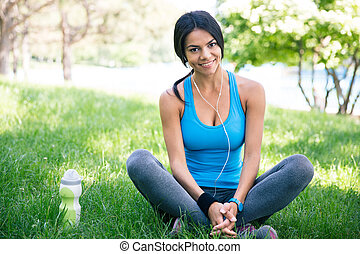 Happy sporty woman resting outdoors - Happy cute sporty...
