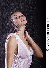 young girl under rain - young brunette caucasian girl under...