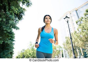 Beautiful woman running outdoors - Beautiful young sporty...