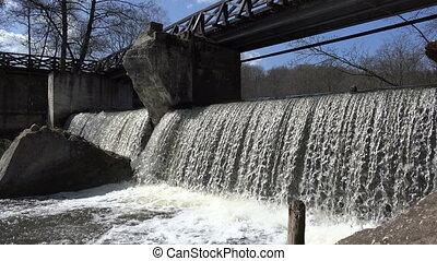 wooden bridge waterfall - Old derelict wooden bridge over...