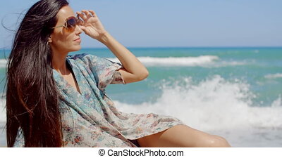 Pretty Young Woman Relaxing at the Beach Sand - Portrait of...