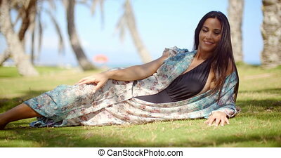 Lady in Beach Dress Relaxing at Grassy Ground - Pretty Young...