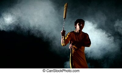 young karate man expertly twirling nunchaku - Costume Bruce...