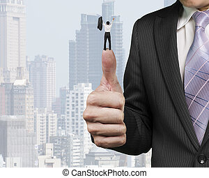 Business man cheering on top of another big thumb