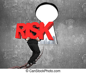 Man carrying red RISK word on chain toward keyhole cityscape...