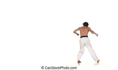 Karate or taekwondo makes a somersault through itself and...